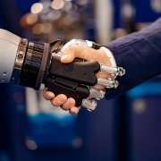 Businessman shaking hands with a robot